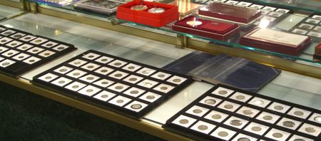 collectible coins, shop counter, medals